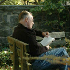 Tom Head reading on bench